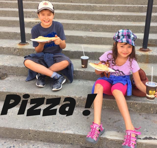 Kids eating pizza at Stampede